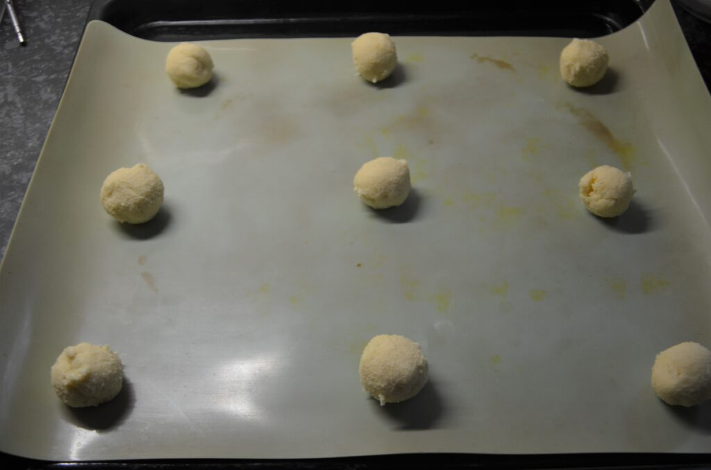 Balls placed on a baking tray, 9 on the sheet with ample space between them