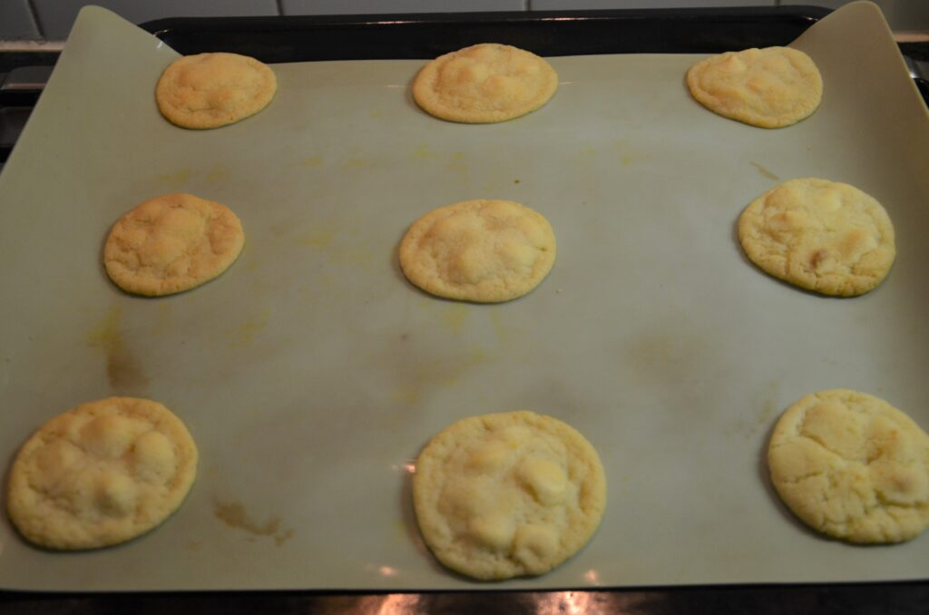 The cookies after baking them, just out of the oven, still on the baking sheet