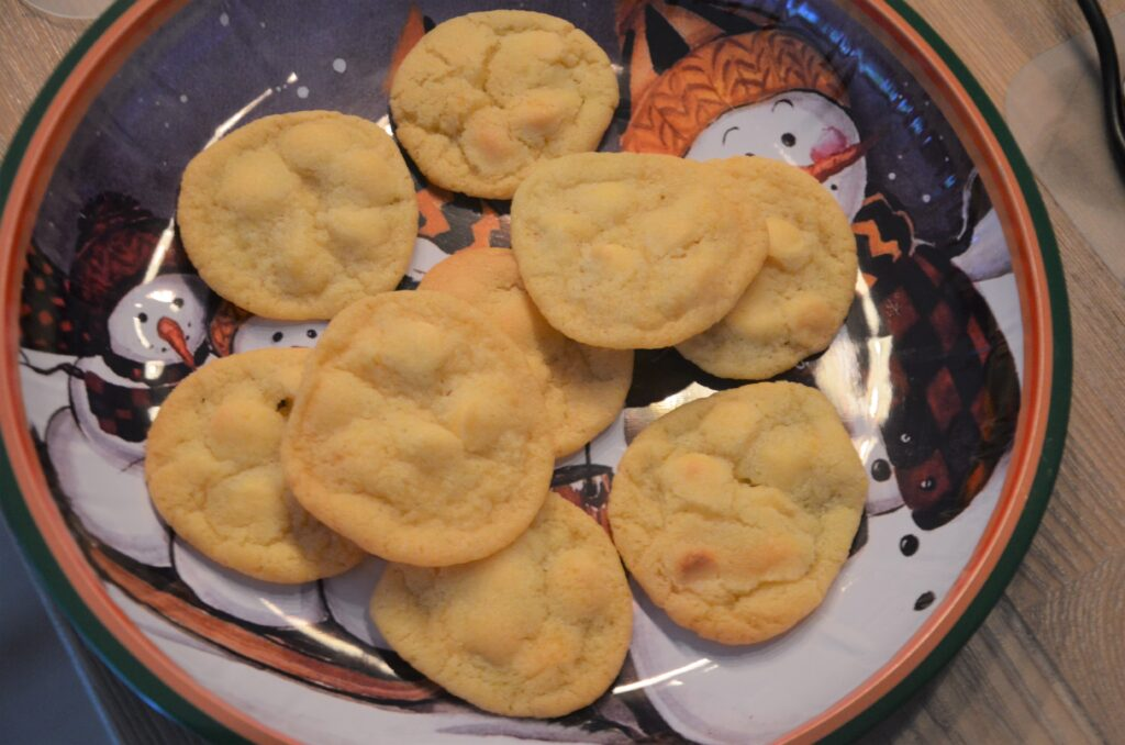 The first batch of White Chocolate Orange Cookies on a CHristmas plate