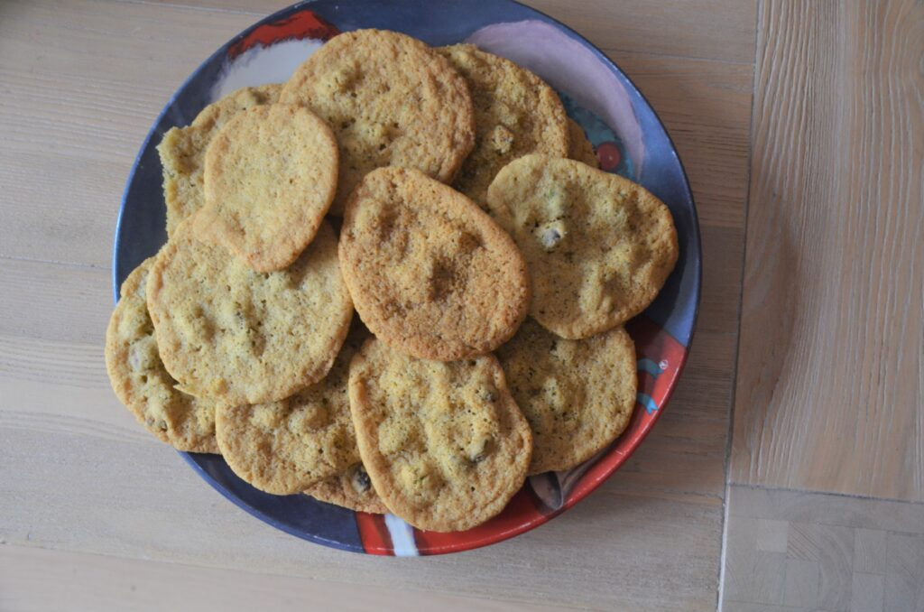 Pistachio Pudding Cookies on a Christmas plate