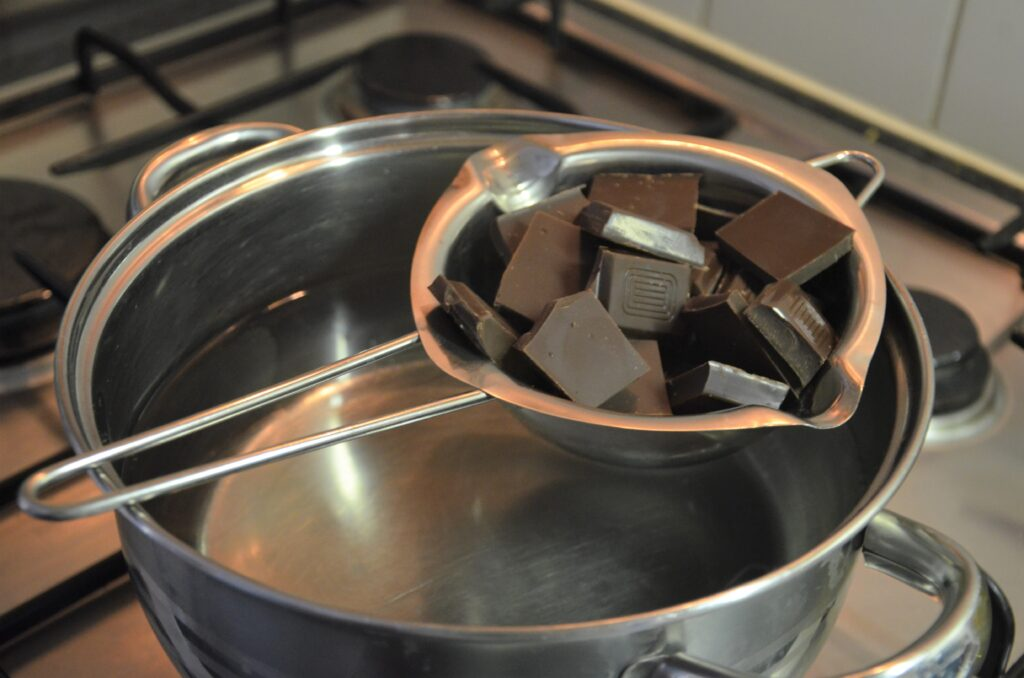 Melting the chocolate above a pan with boiling water