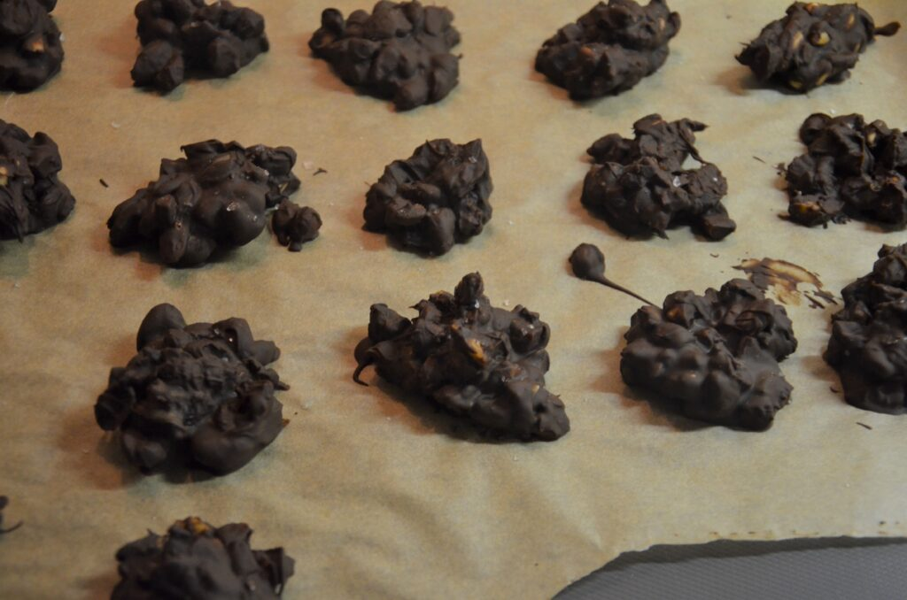 Scoops of cooled chocolate mix on a baking sheet