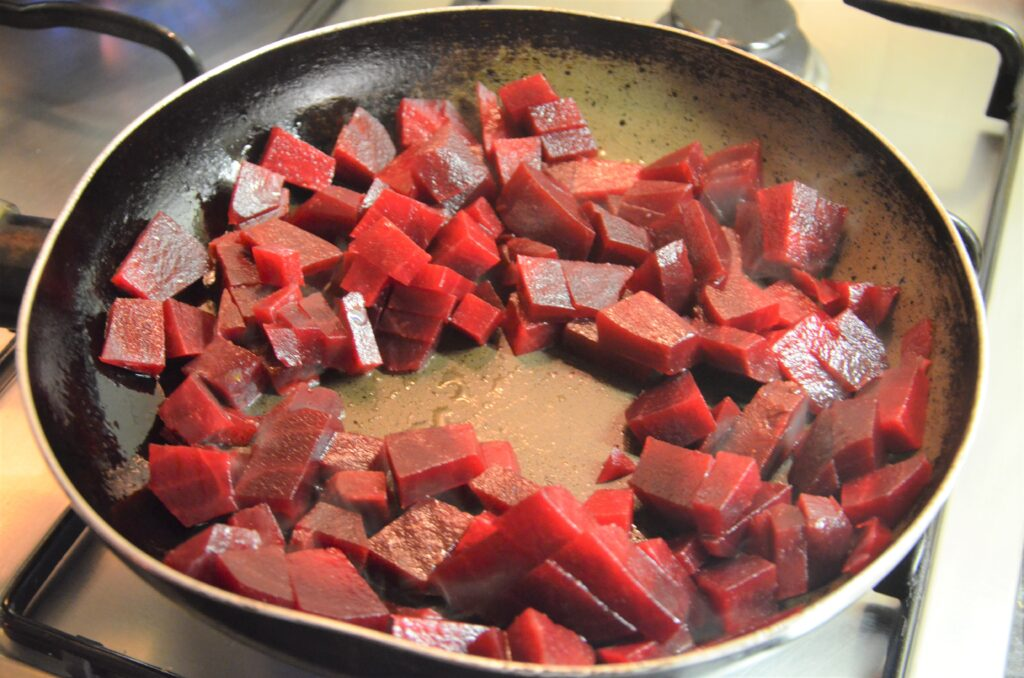 Cooking the red beets in a frying pan