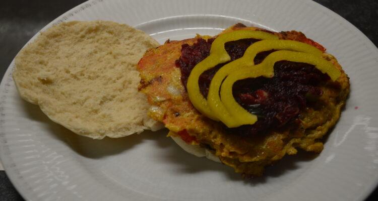 Veggie Omelet Burger on a white plate