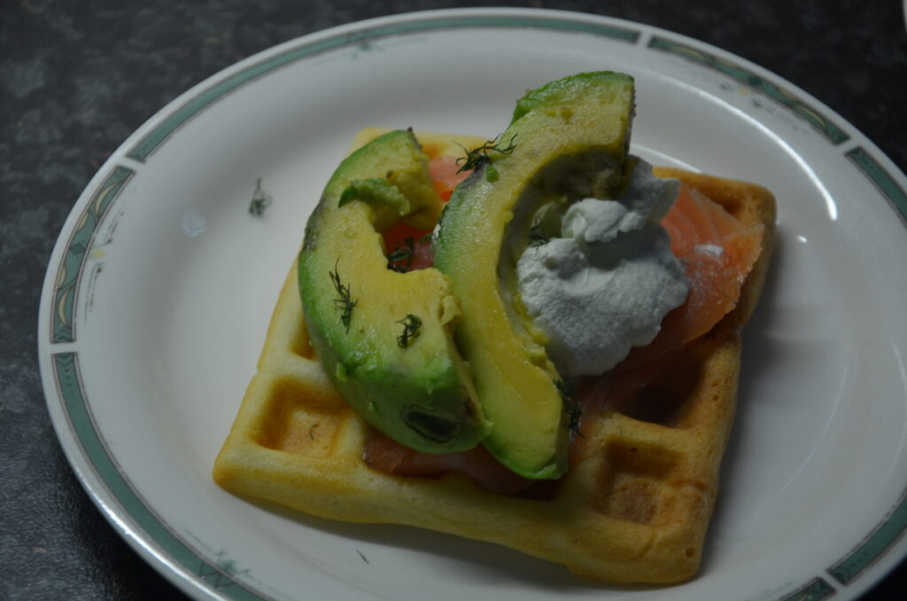 Waffles with avocado and salmon