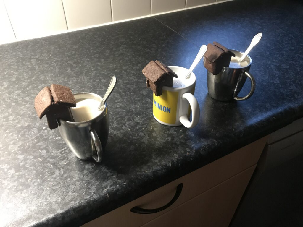 Chocolate Cookiehouses on 3 mugs with Chai Tea Latte
