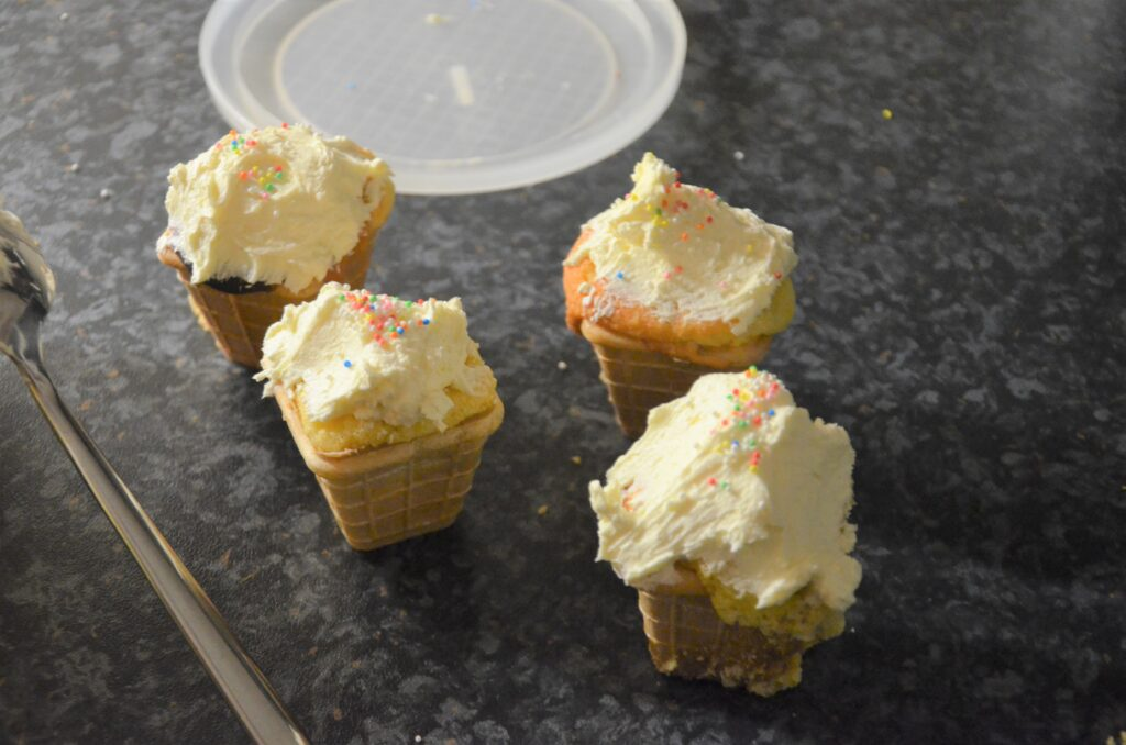 Ice cream cupcakes, 4 decorated on the kitchen counter