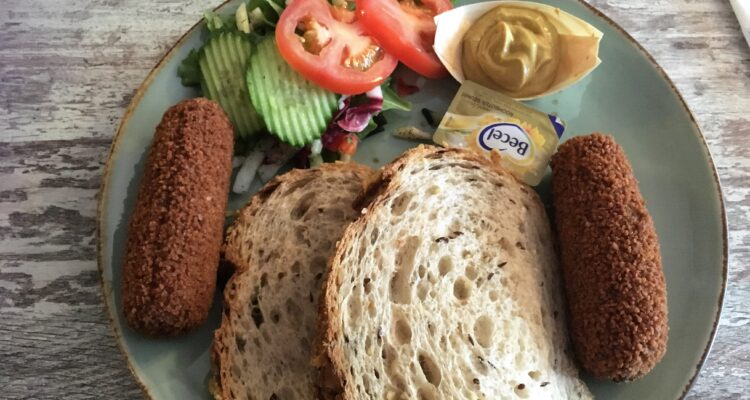 Kroketten with bread, and salad, mustard and butter