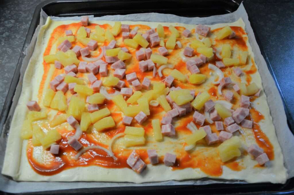 Pineapple added to the pizza