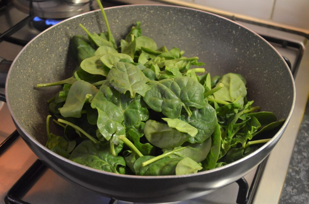 Stir frying the spinach