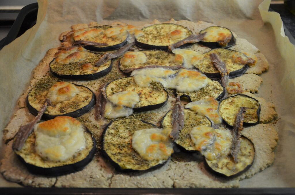 Oatmealpizza with grilled eggplant and anchovy fresh from the oven