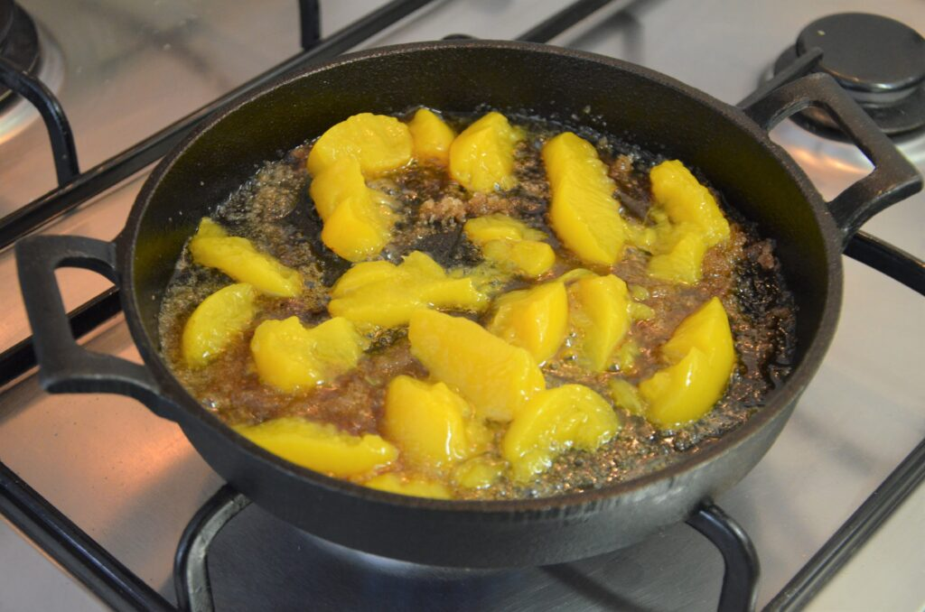 Peaches added to the cast iron skillet