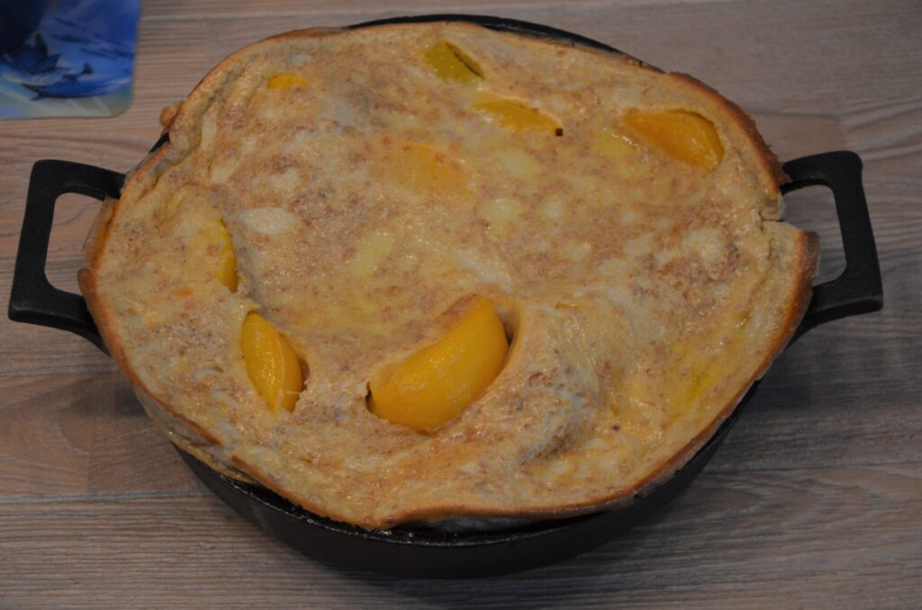 Peach Dutch Baby in the cast iron skillet