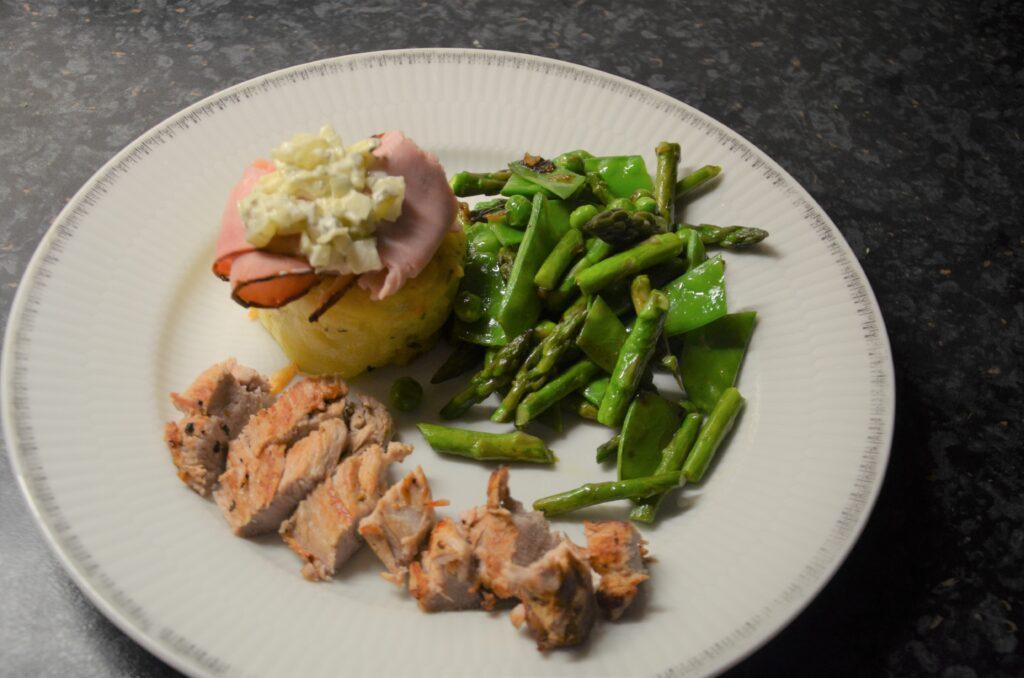 lemon gratins with pork loin, remoulade sauce and spring vegetables