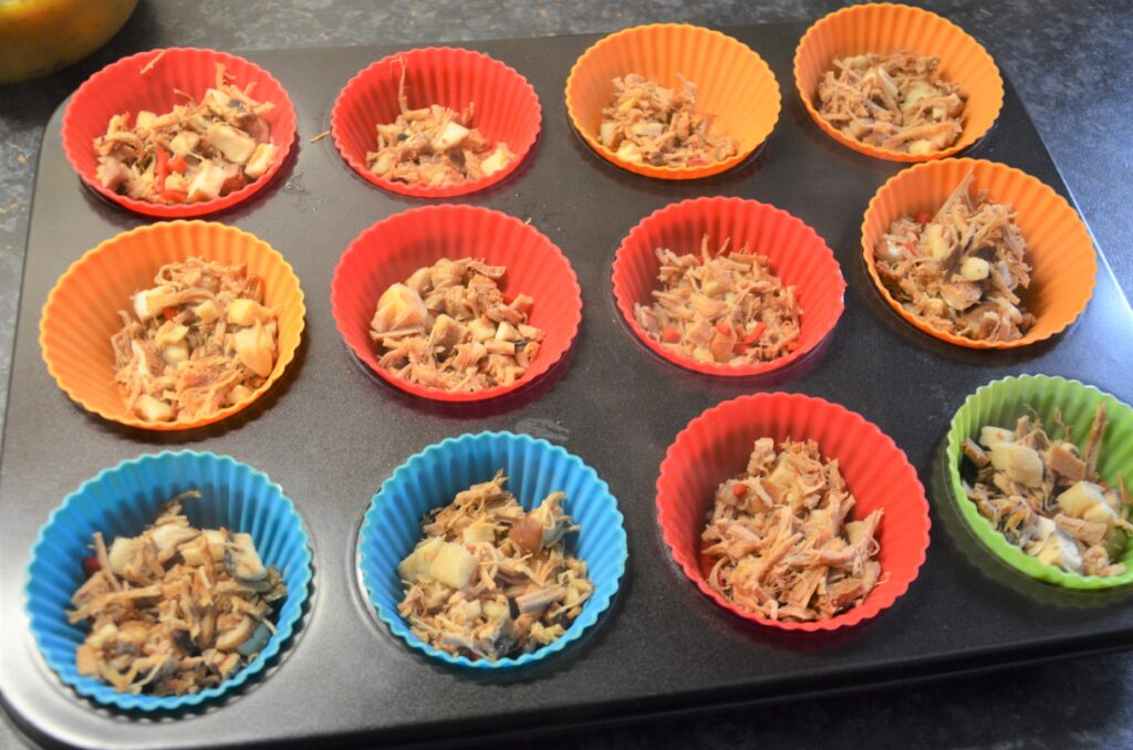 Pulled pork mixture in the muffin tins