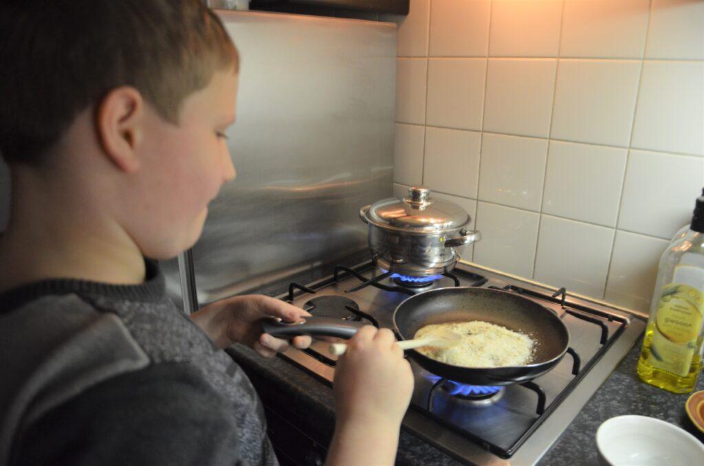 Roasting the breadcrumbs, on the stovetop, Yuri is stirring it.