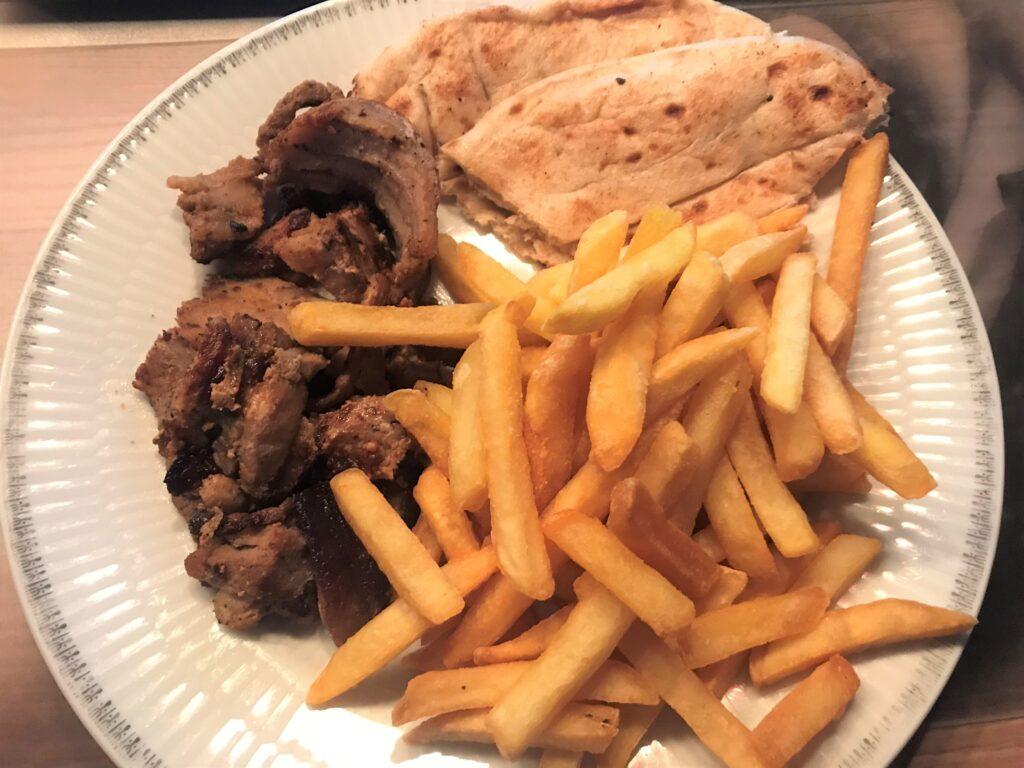 Gyros plate: Gyros, fries, pita bread on a white plate