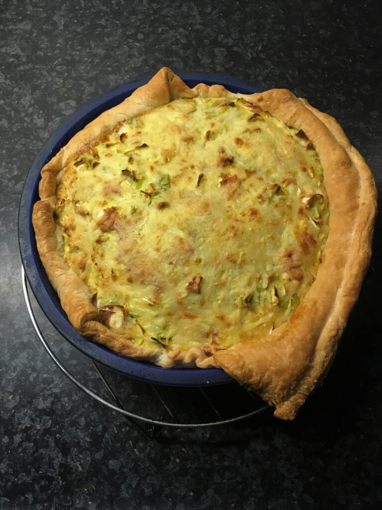 Leek Pie, just out of the oven, still in the mold on a cooling rack