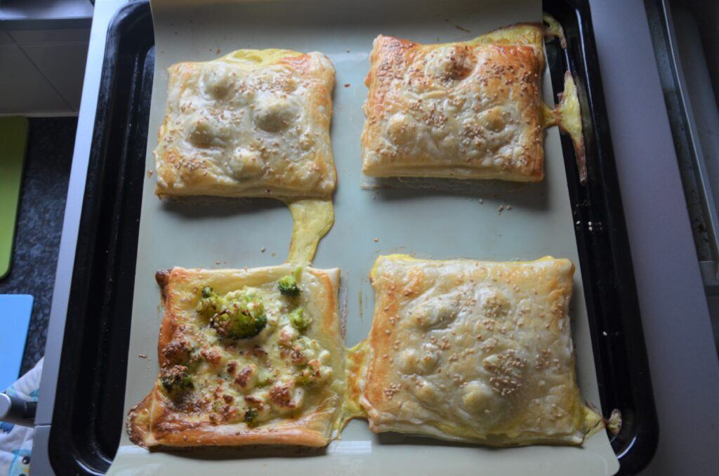 Broccoli and Feta Puff Pastry after baking them, still on the baking sheet